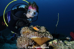 My wife and dive buddy, Cindy, shares a special moment wi... by Mark Hoevenaars 